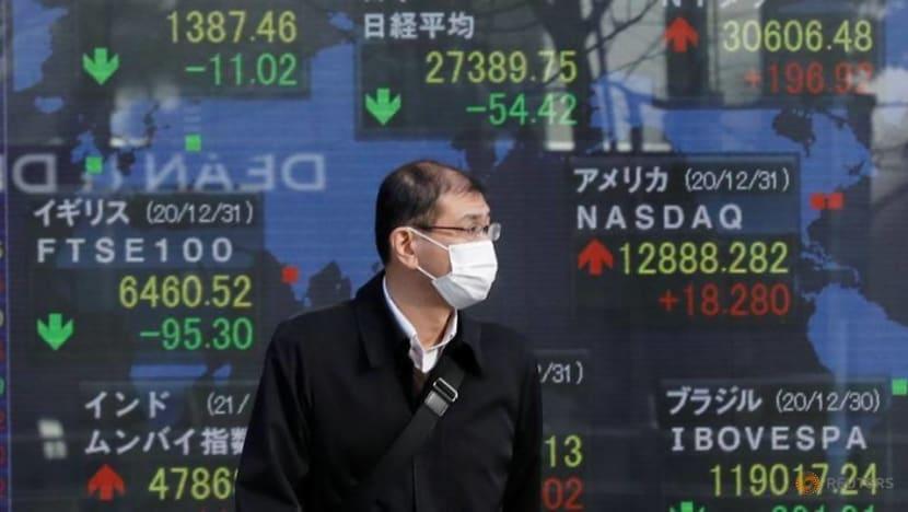 Shares reach record high, oil tops US$60 a barrel