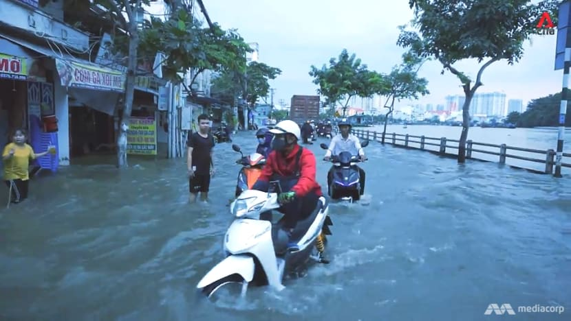 Under siege by climate, man-made problems, a sinking Ho Chi Minh City fights to survive