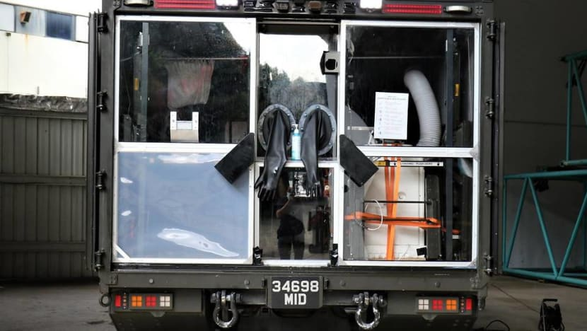 Like a 'giant N95 mask': Safer, faster COVID-19 testing of migrant workers with new mobile swab station
