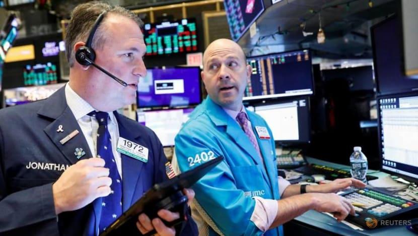 Dow edges to record, but Nasdaq winning streak ends