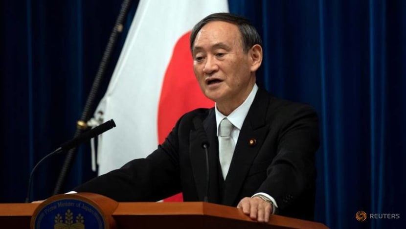 Japan PM Suga trips up with messy reversal on domestic tourism campaign