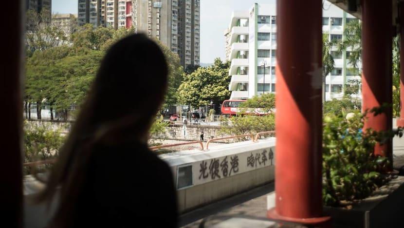 Wedding bells on hold for Hong Kong protester, policeman