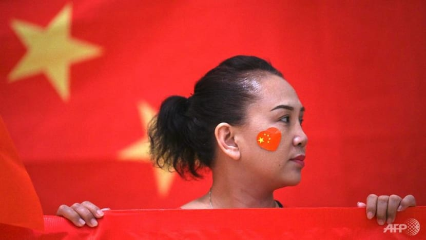 In divided Hong Kong, pro-China groups hold muted anniversary celebrations