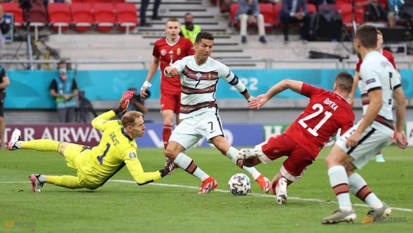 Football: Record-breaking Ronaldo strikes late as Portugal sink Hungary
