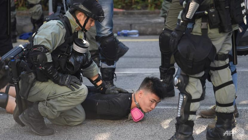 Hong Kong police fire tear gas to break up protesters in Tuen Mun