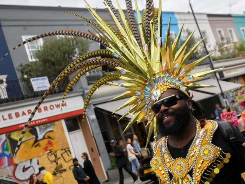 Lone revellers brighten Notting Hill's empty streets on carnival day