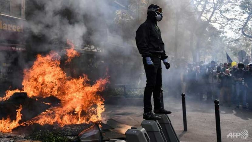 Clashes in Paris as tens of thousands mark May Day