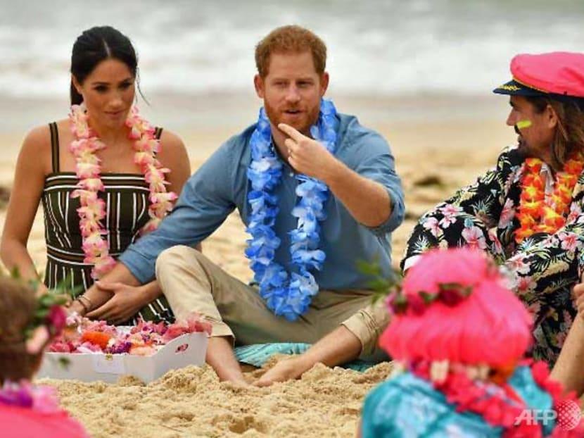 Royals Harry and Meghan go barefoot on Bondi beach