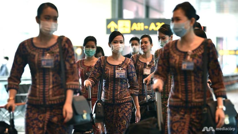 SIA cabin crew to wear face masks on flights as a 'precautionary measure' amid COVID-19 concerns
