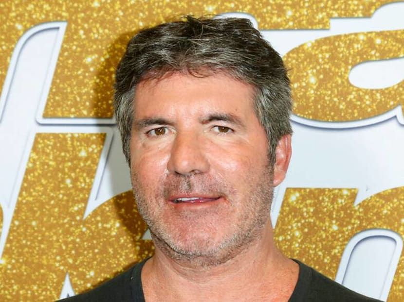 Simon Cowell breaks back, has surgery after falling off new electric bicycle