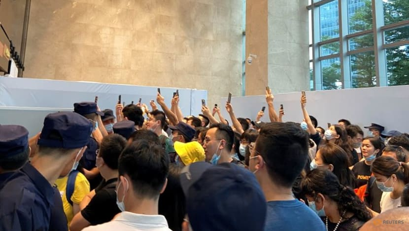 Disgruntled China Evergrande investors crowd headquarters in protest