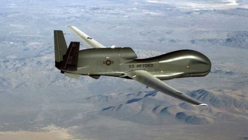 Iran says downed US drone recovered in its territorial waters