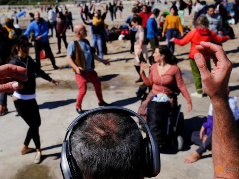 Ravers feel the music at socially distanced silent disco in Barcelona