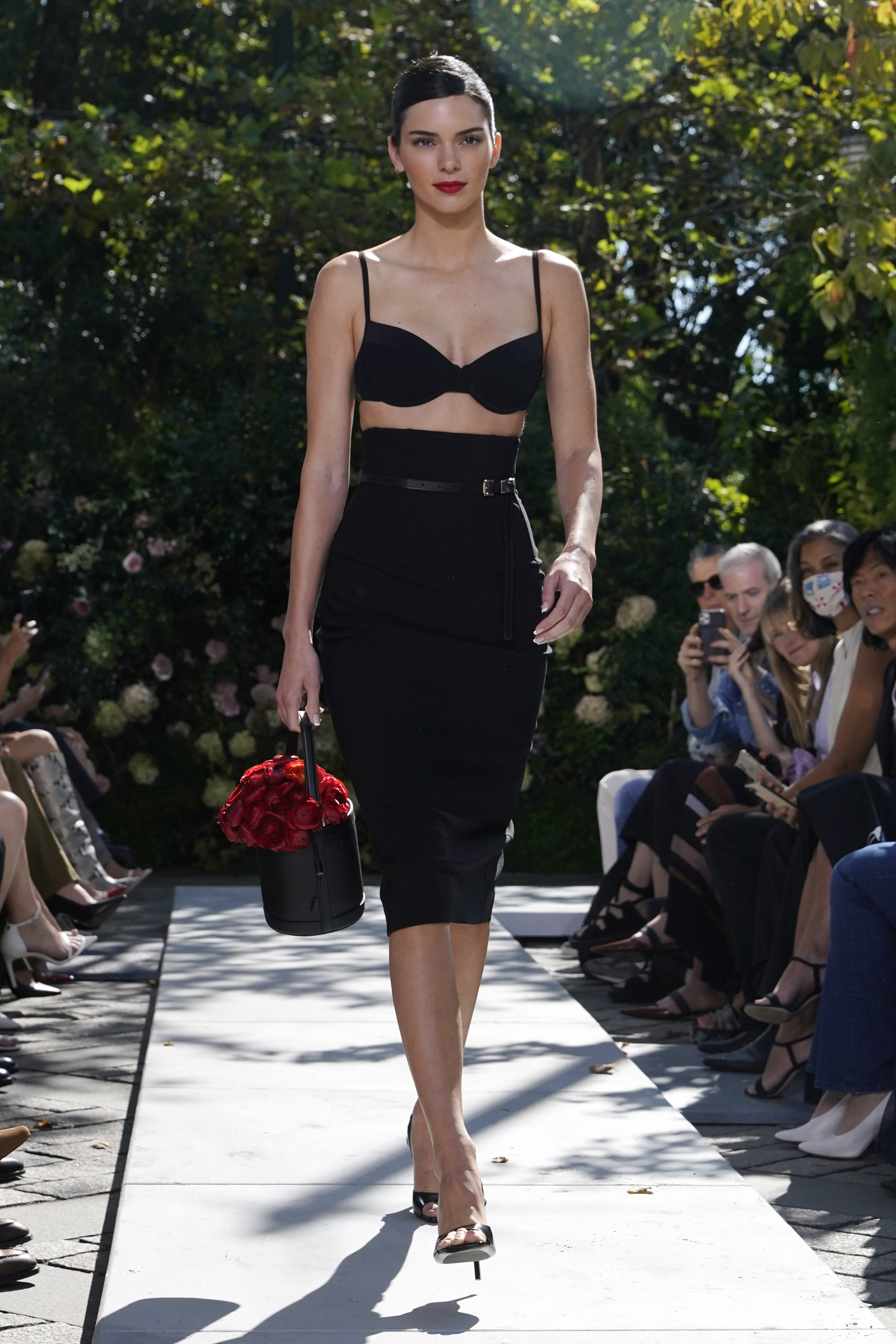 Designer Michael Kors holds first live fashion show since pandemic