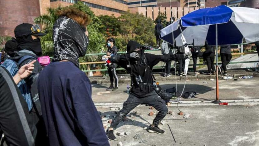 Hong Kong police warn of 'live fire' as campus protest siege deepens