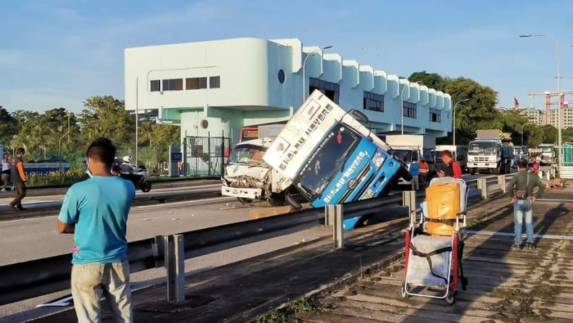 Lorry driver taken to hospital after accident at Yishun Avenue 1