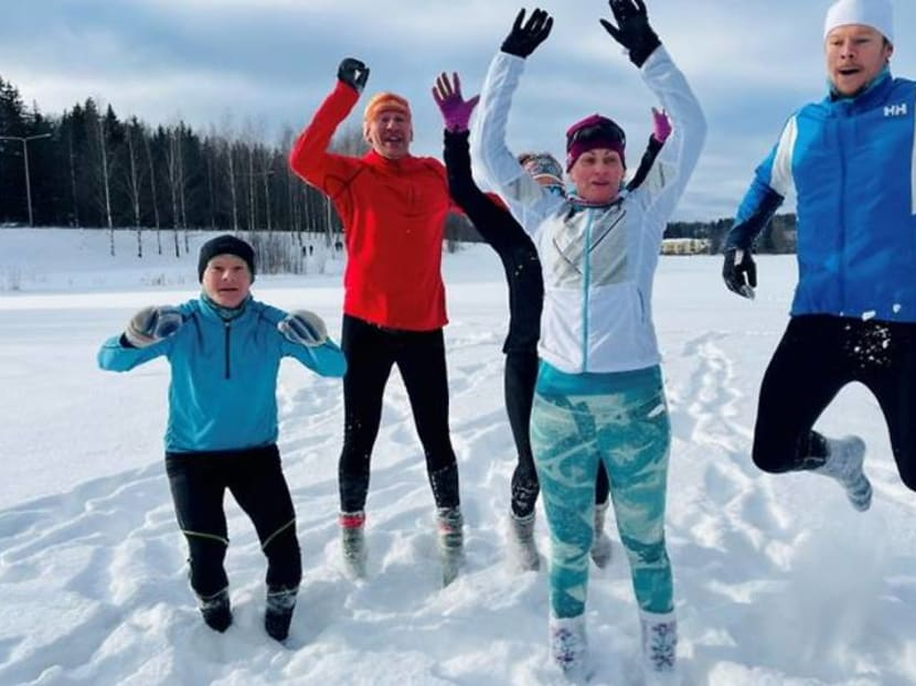 Weary of COVID restrictions, Finns take up running in deep snow in socks