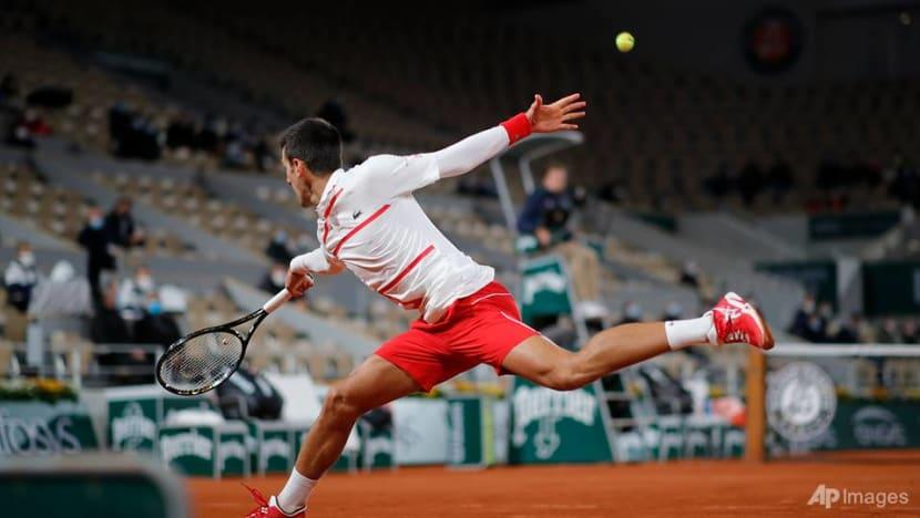 Tennis: Djokovic sweeps past Galan into last 16