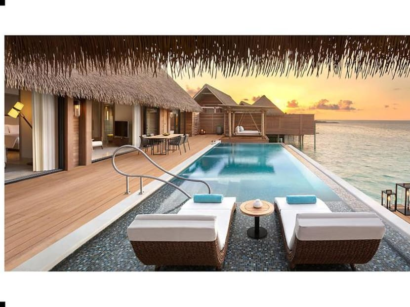 Experiencing Waldorf Astoria in the Maldives, loving the fish in the wardrobe