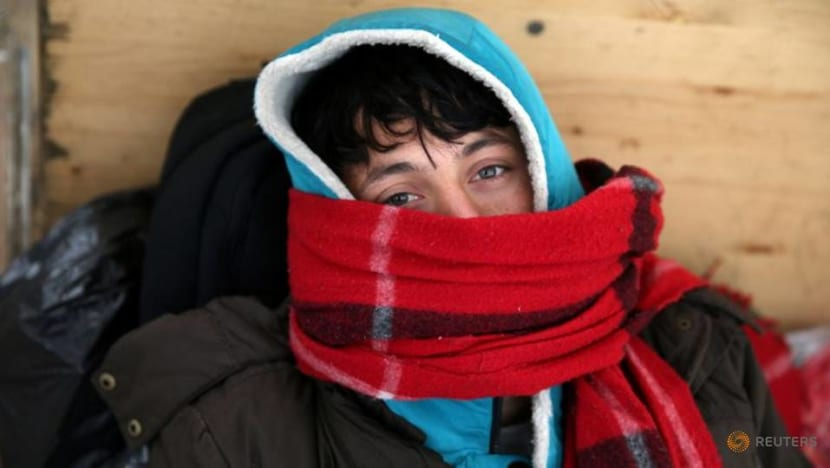 Journey to nowhere: Migrants wait in the cold to be bussed from burnt Bosnia camp