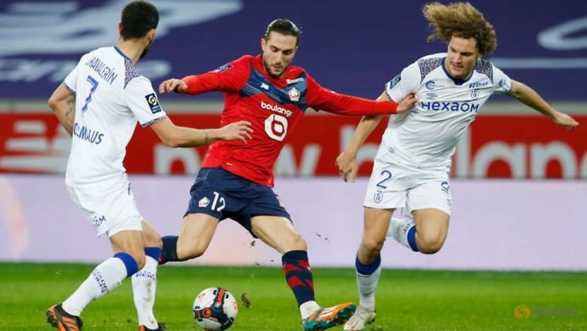 Last-gasp David strike earns Lille 2-1 win against Reims