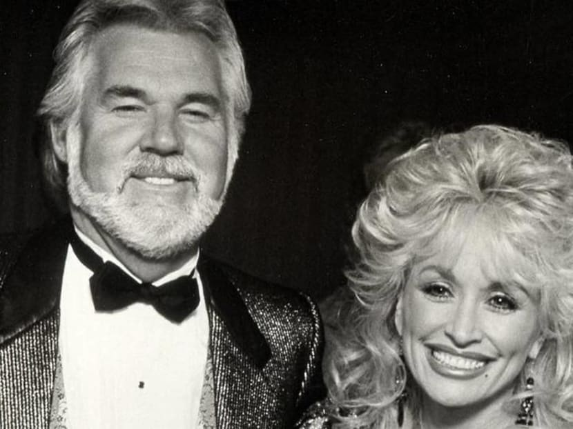 Dolly Parton cries as she gives heartfelt tribute to Kenny Rogers