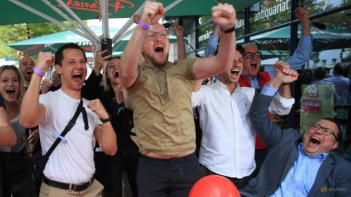 German SPD edges ahead of conservatives in vote to decide Merkel successor