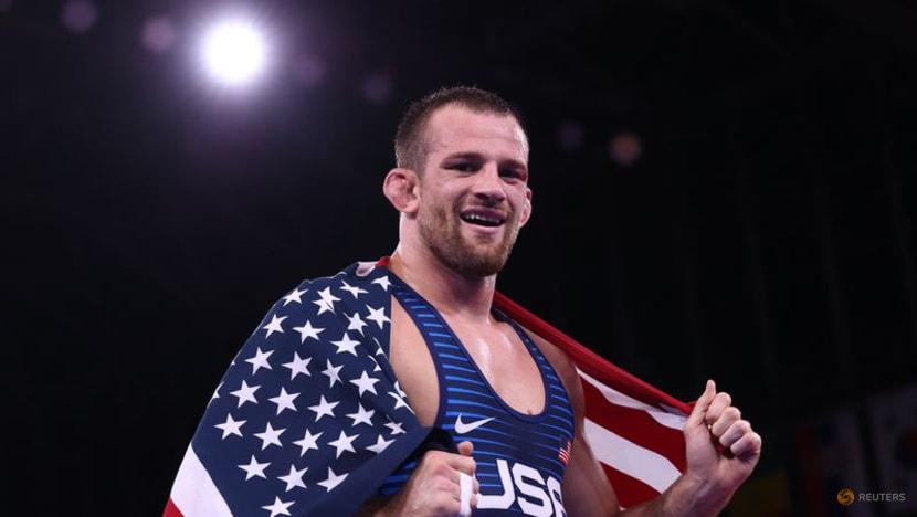Olympics-Wrestling-'Magic Man' Taylor wins final at the death, Japan's Kawai claims gold