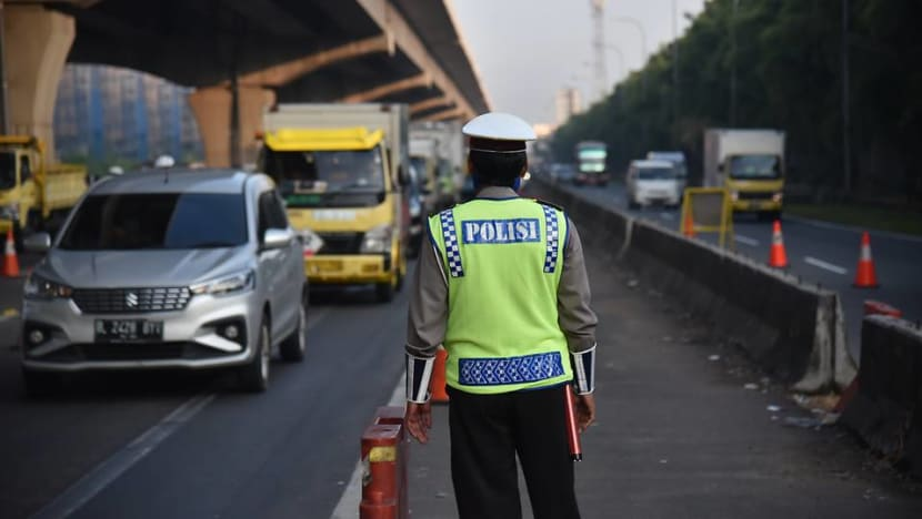 'It'sa cat and mouse game', says Jakarta traffic cop at the frontline ofenforcing Idul Fitri travel ban