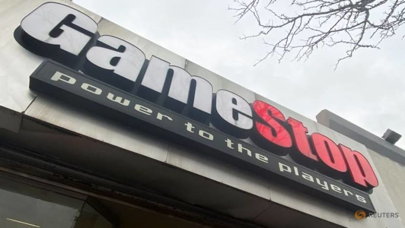 Small investors behind surge in GameStop and other shares hit by trading curbs