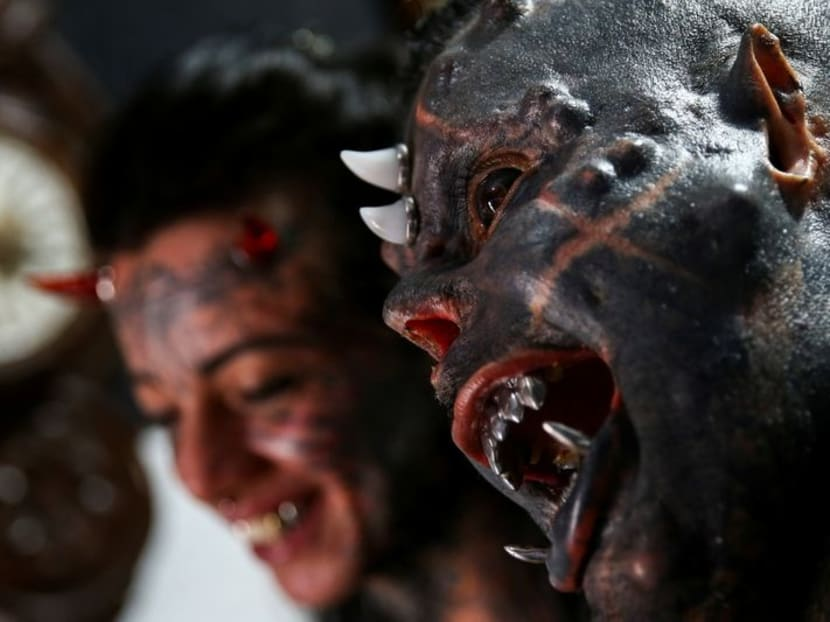 'The sinister attracted me': Brazilian tattoo artist morphs into devil look-alike