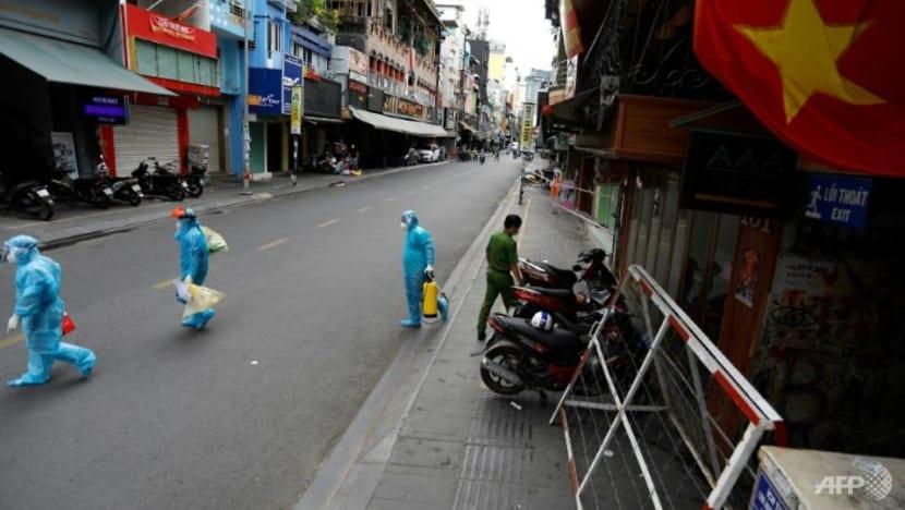 Vietnam's economic hub imposes night curfew as country battles COVID-19 surge