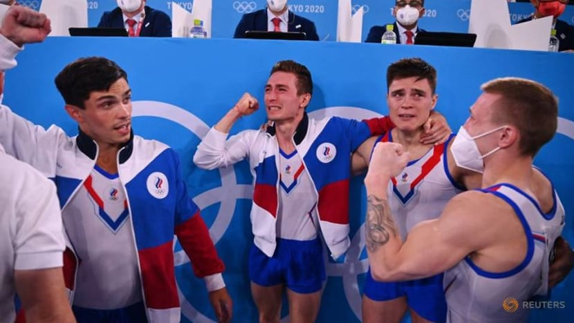 Olympics-Gymnastics-Russia survive Asian fight back to take team gold