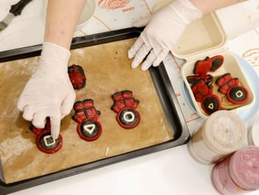 Learn how to make Squid Game-themed Halloween dog treats at this baking class in South Korea