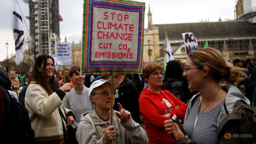 Commentary: Cutting carbon emissions is costly but refusing is costlier