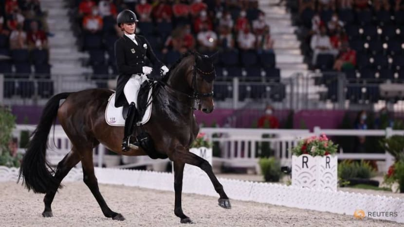 Olympics-Equestrian-Germany strike gold and silver in individual dressage