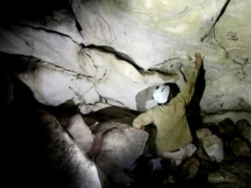 In Mexico, ancient Maya cave reveals mysterious painted hand prints