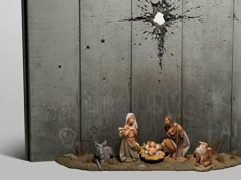 Mysterious artist Banksy's latest work is a dark nativity scene in Bethlehem