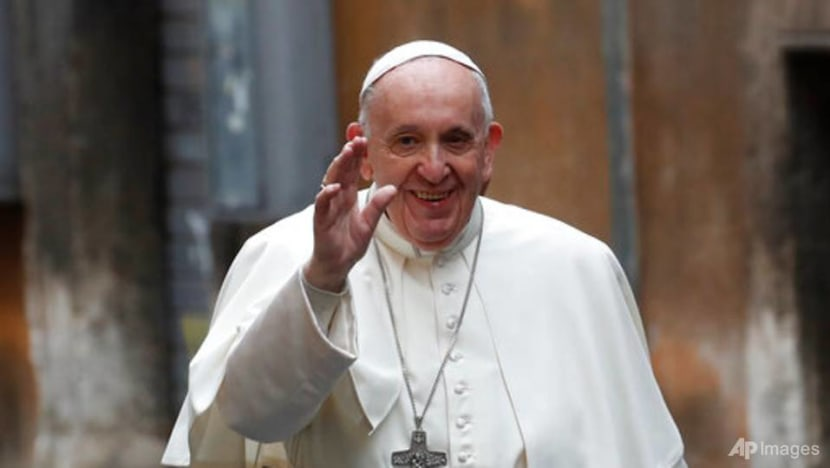 Pope celebrates mass of 'mercy' with prisoners, refugees