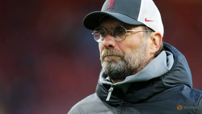 Soccer-Klopp counting on experience of final day stress to seal top-four spot