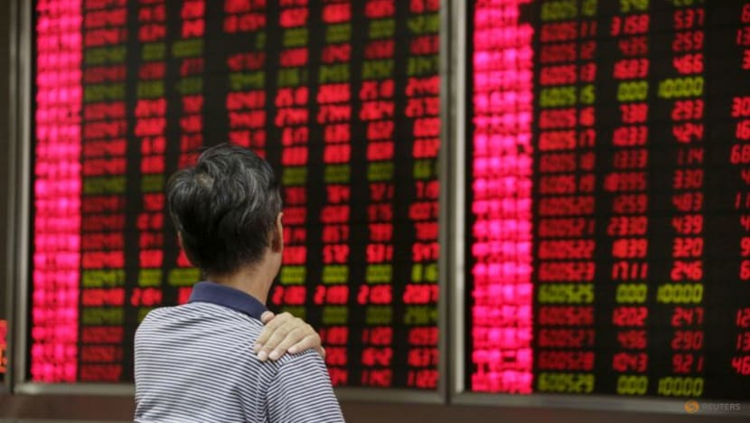 Asian shares pinned at lows after Wall St falls, NZ holds rates steady
