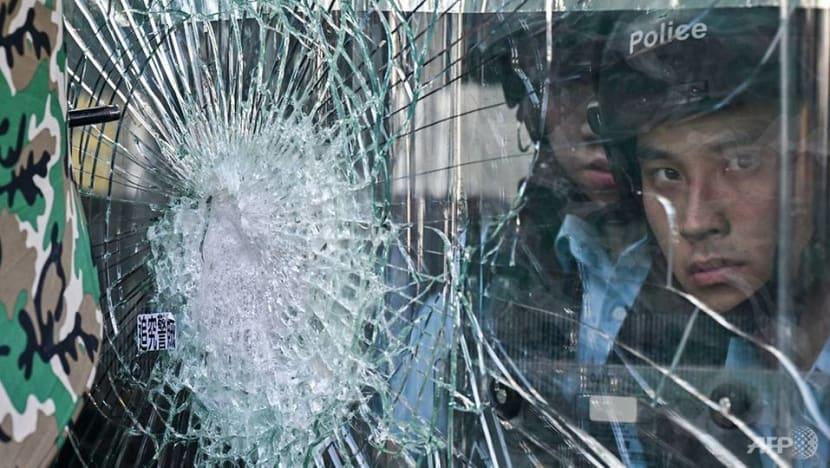 Hong Kong grapples with protest aftermath as China demands criminal probe