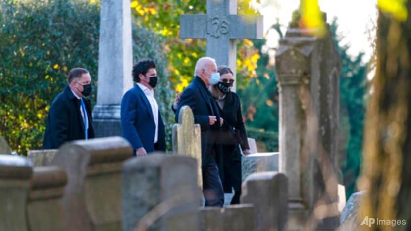 Biden begins US election day visiting son's grave