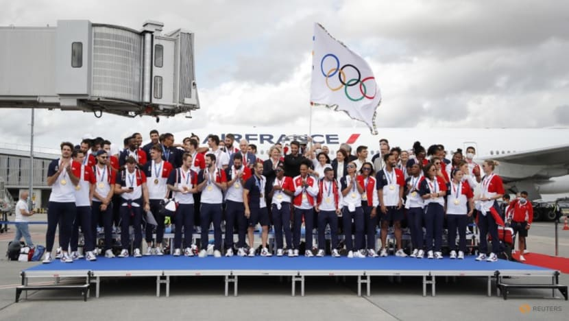 Flying the Olympic flag, Paris looks beyond COVID for 2024 games