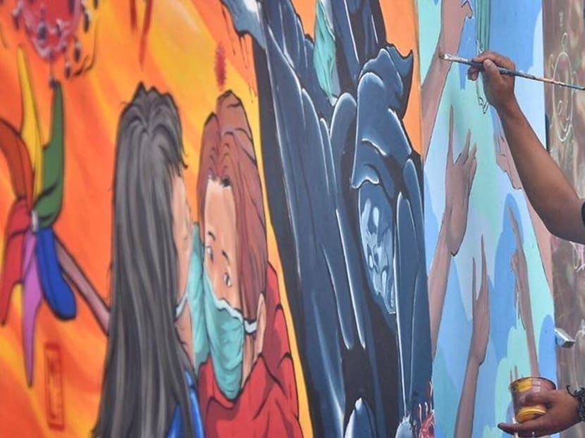 Livelihoods hit by COVID-19, Indonesian mural artists channel efforts towards positive messages