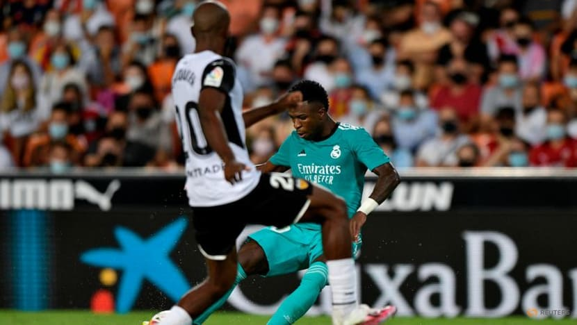 Football: Real Madrid stage late comeback to win at Valencia
