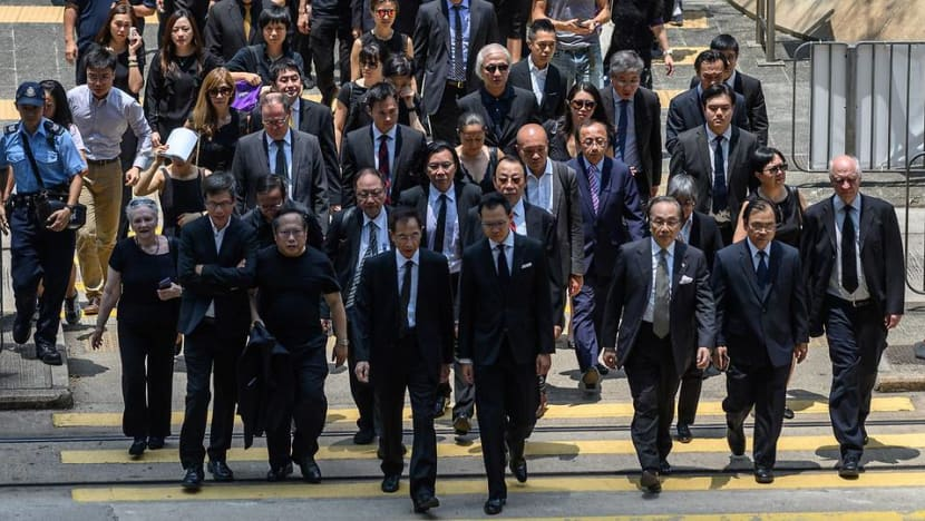 Hong Kong lawyers march in silence to support anti-government protesters