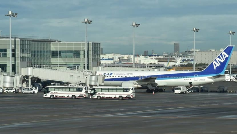 Plane carrying Japanese evacuees from Wuhan lands in Tokyo, 5 reported ill