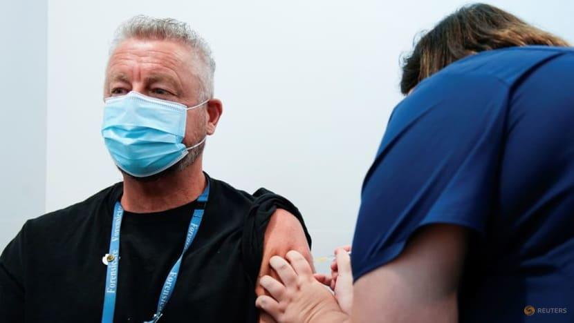 Australia hits vaccine milestone as Melbourne COVID-19 cases hover near record levels