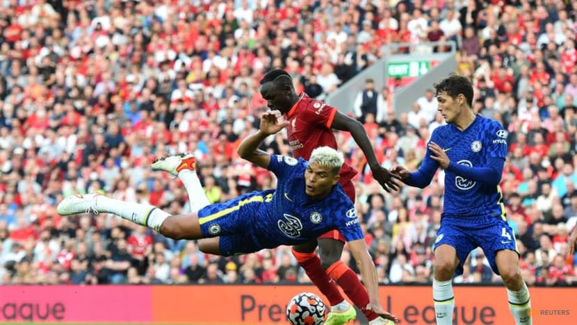 Football:Ten-man Chelsea hold on for point at Liverpool